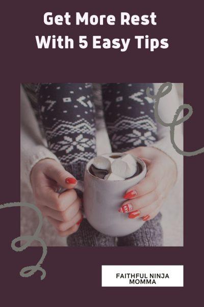 Winter socks and woman holding mug of hot cocoa